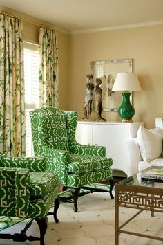 aired with warm and light neutrals, these green chairs enliven the room with their color and geometric pattern.