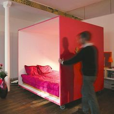 Design for studio apartments, or 1 room apartments, make a bedroom on wheels, add a pop of color, and create privacy, with some curtains, and a DIY projector wall
