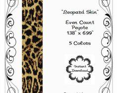 Snow-Leopard-Half Face ist ein PDF Peyote Stich Muster mit 11/0 Miyuki Delicas.  Das PDF-Muster enthält Folgendes:  (1) die Musterung 2. große