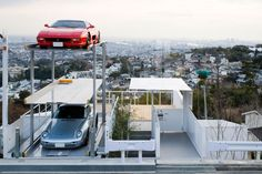 kenji yanagawa case study house designboom   I think I had this toy as a kid. You turn the crank and lift the car-elevator... (More seriously, I suppose it's about the only way to combine 3 expensive cars + the densely populated area. But it looks so precarious!)