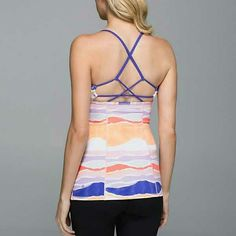 Lululemon Dancing Warrior Tank Great tank in bleacher stripe white and iris flower (who comes up with these color names!?). Really amazing strap pattern on back that helps keep you supported as you sweat it out! Never worn and NWT! lululemon athletica Tops