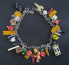 Junk charm bracelet...fun little pieces  Collect pieces of everything to use in all kinds of stuff...