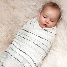 Sleep tight, baby in our silky soft muslin swaddles.