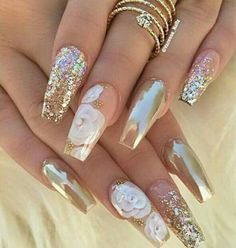 Chrome gold and white rose nails.