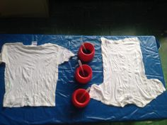 Tie Dying with Toddlers - We soak the shirts in soda ash just like if you were using traditional tie dying.  We work with 2 at a time and this is how we set it up.