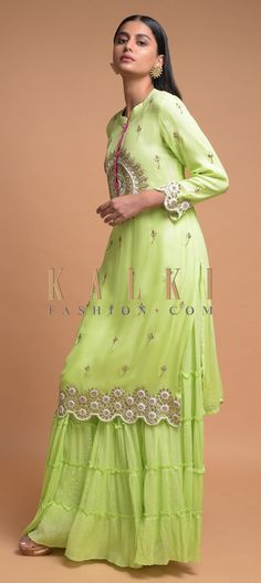 Buy Online from the link below. We ship worldwide (Free Shipping over US$100)  Click Anywhere to Tag Pastel Green Sharara Suit In Georgette With Embroidered Round Motif On The Yoke Online - Kalki Fashion Pastel green sharara suit in georgette adorned with zari, gotta patches, zardozi and thread embroidered round motif on the yoke.Further enhanced with floral buttis and semicircle cut hem with floral motifs.Designed with mandarin collar and 3/4th sleeves.