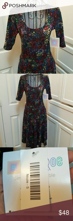 LuLaRoe Nicole Dress New with tags eautiful patterned LuLaRoe Nicole Dress. Colors include, black, yellow, dark red, purple, blue and amerald green. LuLaRoe Dresses