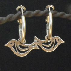 Danon Small Silver Bird on Small Hoop Earrings at Lizzieane.com Was £26 Now £20.80 http://www.lizzielane.com/product/danon-silver-bird-on-small-hoop-earrings/