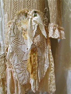 Romantic OOAK Doily Sweater Coat embellished with lace and doilies in a shabby magnolia style. This long sweater is refashioned with layers of vintage crocheted doilies and vintage bobbin lace doilies. Other embellishments include vintage lace trims, vintage lace fabric, wide scalloped edge lace, new tattered lace fabric, beaded / sequined lace trim, satin ribbon roses, vintage faux pearl beads, beads, buttons, and brass findings. For closure, sweater ties on front. Soft ruffle lace for…