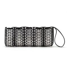 This stylish 11 by 5 inch bag has a wrist strap fashioned out of tire inner tube that doubles as a zipper pull. Inside is a credit-card size pocket in the black cotton lining. Meet the Artisans The fo