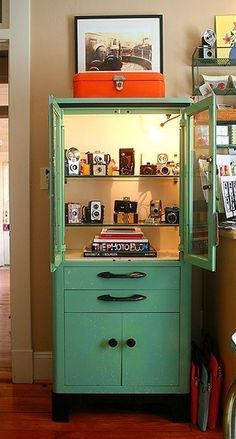 vintage medical cabinet- this is the exact medical cabinet I have...my lights do not work though, and mine is blue.