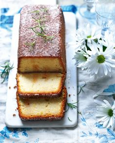 A twist on the classic drizzle cake, with the addition of clotted cream and rosemary.