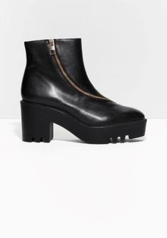 With a winding gold-tone zip, these chunky statement boots feature an eye-catching, jagged, rubber platform.