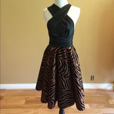 Vintage Inspired Zebra Print Convertible Dress Custom made convertible top dress ,bust measurements are one size ( and you don't have to wear a bra!!!!)  the top can be converted a multitude of ways. I was able to come up with 15 new ways to tie , and have shown a few examples in pictures. The skirt is a full circle and is done in a bronze taffeta with black velvet zebra stripes. Convertible top in black taffeta. Waist measures 26-28 Skirt length( from waist to hem) 26 inches. Dress has been…