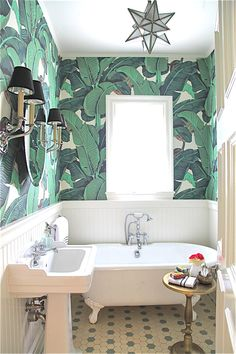 We're loving this tropical banana leaf print for practically everything. Take a peek at these cool banana leaf print wallpaper, wall art, bedroom headboard and pillow ideas. This summer-ready pattern is certain to spruce up any dreary space in your house. Small Bathroom Wallpaper, Palm Wallpaper, Powder Room Wallpaper, Bedroom Wallpaper, Tropical Wallpaper, Print Wallpaper, Wainscoting Bathroom, Wainscoting Height, Black Wainscoting