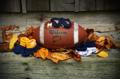 Unique boy football maternity photo in fall.Cleveland browns instead! Unique Maternity Photos, Cute Pregnancy Photos, Winter Maternity Photos, Maternity Poses, Maternity Pictures, Baby Pictures, Newborn Baby Photography, Maternity Photography, Fall Baby Photos