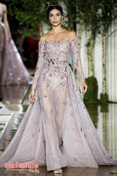 """She's young, modern, and rock, but elegant at the same time,"" Murad offered backstage, adding, ""She's also rich. Her dresses are full of jewels, transparency, and tattoo ornamentation.""   When not…"