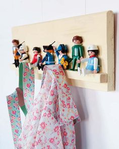 """Toys attached to wood shelf & used as hooks. Too cute. Wonder if you could use animals for this project. Like elephant trunks--little """"shelf"""" would have to be wider to accommodate the animals."""