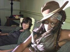 Dana Soto ‏@Dana_narciso   Danai Gurira(Michonne) and Chandler Riggs(Carl) rest during the making of CODA midseason finale of the fifth season.