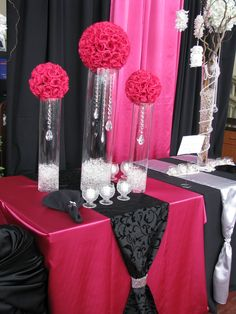 Fuschia table covering with black swirl damask runner topped with fuschia rose balls, crystal bling, and each with underwater lighting. Table Arrangements, Table Centerpieces, Wedding Centerpieces, Flower Arrangements, Wedding Decorations, Fuschia Wedding, Wedding Colors, Wedding Flowers, Hot Pink Weddings