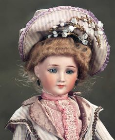 Value Points: very beautiful face on the sought-after model,with fine quality of bisque and painting,original body designed to accommodate flapper-style costuming,original body finish and wig. Realized Price: $3,300The Dolls in the House at the Top of the Hill: 305 German Bisque Lady,1169,by Simon and Halbig with Flapper Lady Body