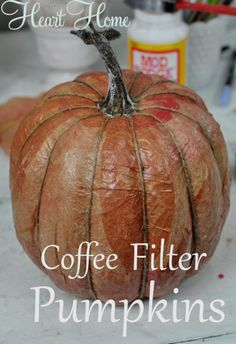 This little coffee filter pumpkin turned out great! I used natural coffee filters painted with watered down acrylics which was perfect for covering the pumpkin Faux Pumpkins, Halloween Pumpkins, Fall Halloween, Halloween Decorations, Fabric Pumpkins, Burlap Pumpkins, Plastic Pumpkins, Velvet Pumpkins, Halloween Crafts