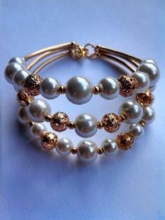 Mod:P64 Pulsera chapa de 14 y perla de cristal $129.00 mayore del 25% descuento $97.00