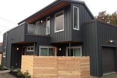 Laneway Home-Laneway House @Marlinda Bellingham & Main: Grey Hardie Board and batten siding contrasting with the cedar fence finely crafted by the landscap...