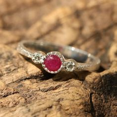 Round cabochon beautiful ruby ring in texture sterling silver band and twin side set diamond gemstones