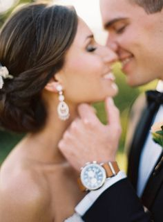 great pose...sans the watch . unless it was a gift from the bride as it distracts from the romance of the moment caught