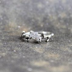 Raw Uncut Rough Diamond Solitaire Promise Ring via Etsy.--can't decide if I would want an uncut diamond as an engagement ring, maybe a combination of both? just thinking~AO