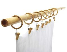 Shower Curtain Rings  Bamboo is beautiful, renewable, and we're thrilled with those clasps -- you could turn any length of fabric into instant curtains, no sewing required. Bamboo Button Curtain Clip, set of 7 for $29 (matching rods available as well)