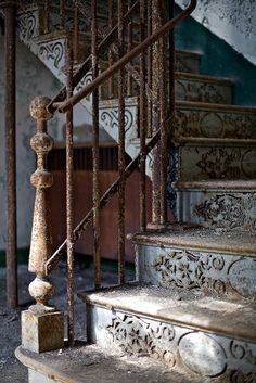 Rusted embossed metal stairs in the perfectly faded shade of blue