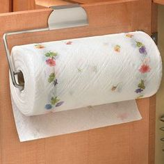 """Over-door paper towel holder with a brushed nickel finish.   Product: Paper towel holderConstruction Material: MetalColor: Brushed nickel Features: Over-the-door design Dimensions: 5"""" H x 11.75"""" W x 1.63"""" D"""