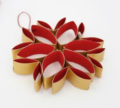 I'd adhere book pages to card stock and use it to make this ornament with print on the inside and a solid color on the outside.