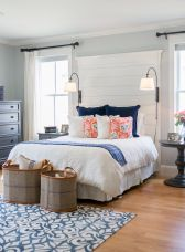 Navy, coral and cream master bedroom with shiplap headboard