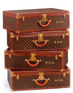 vintage Louis Vuitton suitcases (a stack of these also makes a lovely side table)