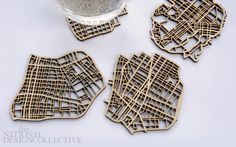 City-shaped coasters lasercut from birch plywood. SF, LA, Chicago and NYC. $35.00