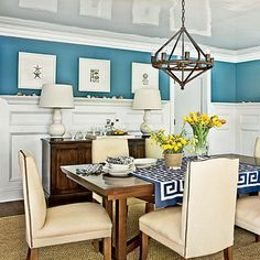 To ensure the dining room leaves a lasting impression, the designer had the ceilings lacquered in gray and installed wainscoting to create architectural interest. coastalliving.com
