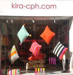 Our beautiful and colorful kira-cph.com cushion covers are floating in our shop window today