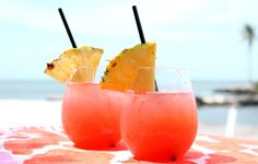 Tropical Rum Punch Recipe Beverages with Malibu Caribbean Rum, rum, cranberry juice, orange juice, pineapple juice, ice, pineapple slices