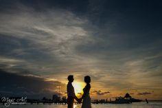 Bride and groom silhouettes in Cancun, Mexico. Magic Art Wedding Studio, destination wedding photographers
