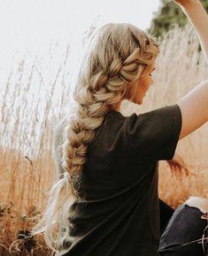 Long blonde plait.