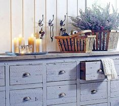 Lilac chest of drawers. I like the faded wood and the pop of color; want longer drawers