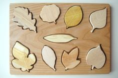 Wooden puzzle pieces that are beautifully crafted from the same wood as the leaves. What a great idea!