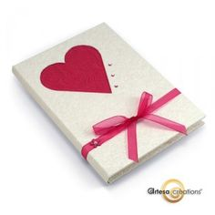 White book with red heart cutout