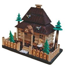 "Wooden House.  Polish Village House. Available in 3 sizes, striking with detail accuracy may be an excellent history cultivation piece. The villages near mountain regions are well known throughout Poland to be unique in one way; they make some of the most beautiful log houses in the world. This is a very accurate depiction of a typical log house found in the Carpathian mountains.  This villager log house is made of  pieces of wood, plastic and rock. Dims: 9.25"" L x 5.5"" W x 7.5"" H"