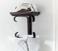 Simple and clever storage for an iron and ironing board. #StorageWorks