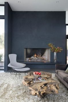 LOVE the intentionally blank fireplace walls!