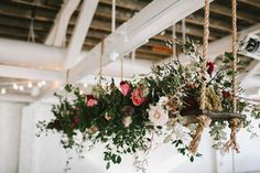 hanging floral centerpieces - photo by w&e photographie http://ruffledblog.com/sentimental-loft-wedding-in-birmingham